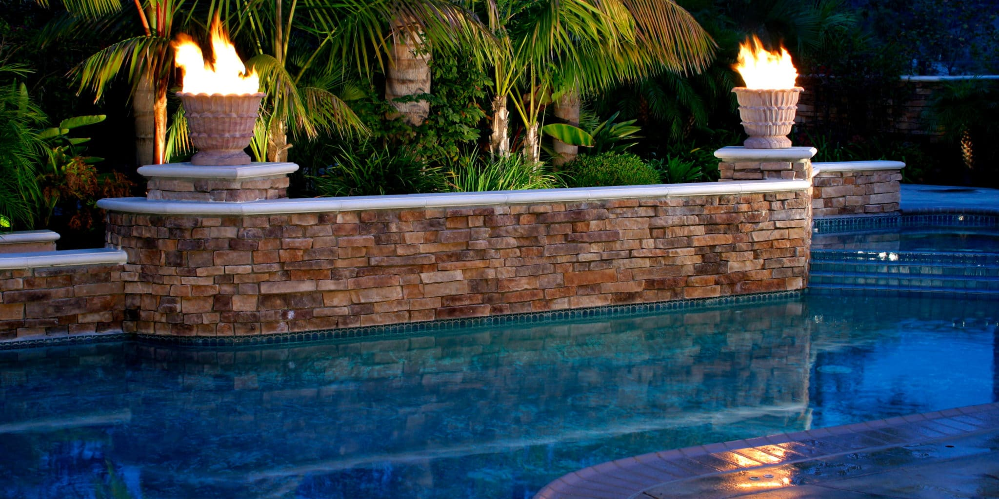 Pool fire features custom pools downunda pools houston for Pool with fireplace